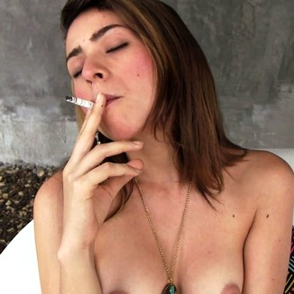 Smoke Loving Latina Bares Breasts